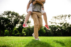 Close up of young beautiful couple rejoicing in park. Royalty Free Stock Photos