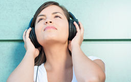 Close-up of young beautiful girl enjoying music on headphones Royalty Free Stock Images