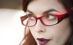 Close up of young beautiful traveler wearing reading glasses Stock Photography