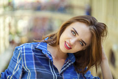 Close up of young beautiful woman in a checkered blue shirt Stock Images