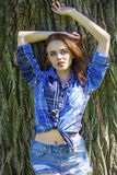 Close up of young beautiful woman in a checkered blue shirt Stock Image