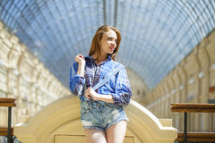 Close up of young beautiful woman in a checkered blue shirt Stock Photos