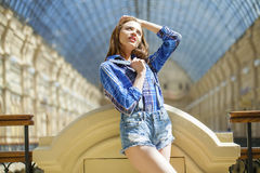 Close up of young beautiful woman in a checkered blue shirt Stock Photography