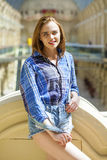 Close up of young beautiful woman in a checkered blue shirt Royalty Free Stock Images