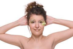 Close up young beautiful woman with feather Royalty Free Stock Image