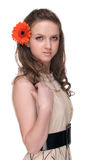 Close up of young beautiful woman with flower Stock Images
