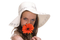 Close up young beautiful woman with hat and flower Stock Images