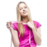 Close-up of a young beautiful woman holding meter royalty free stock images