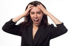 Close-up of a young beautiful woman looking shocked, holding her head Royalty Free Stock Images