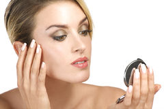 Close up of a  of young beauty woman with mirror Stock Photos