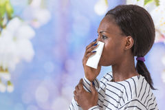 Close up of young black business woman blowing her nose Stock Photo