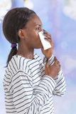 Close up of young black business woman blowing her nose Royalty Free Stock Photo