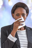 Close up of young black business woman blowing her nose. African business woman blowing her nose royalty free stock images