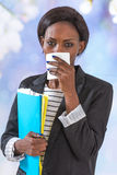 Close up of young black business woman blowing her nose. African business woman blowing her nose stock photos