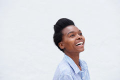 Close up young black woman laughing against white background Stock Images