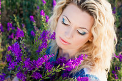 Close-up of young  blond woman in sage field Stock Photography