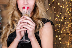 Close up of young blonde woman with a glass of champagne Royalty Free Stock Photo