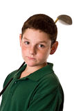 Young boy holding a golf club. A close up of a young boy holding a golf driver over his shoulder isolated on a white background Royalty Free Stock Photos