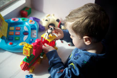 Close up of a young boy playing. A Close up of a young boy playing with toy train royalty free stock photos