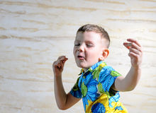 Close Up of Young Boy Singing and Dancing Stock Image