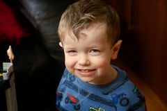 Close up of a young boy smiling. A Close up of a young boy smiling royalty free stock photo