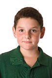 Young boy wearing a green polo shirt. A close up of a young boy wearing a green polo shirt isolated on a white background Stock Images