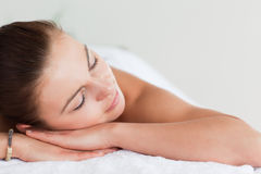 Close up of a young brunette lying in a spa Royalty Free Stock Photography