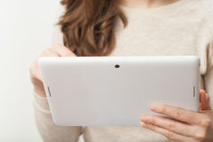 Close up young business woman holding tablet pc Stock Photo
