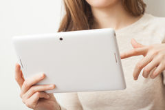 Close up young business woman holding tablet pc Royalty Free Stock Image