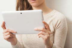 Close up young business woman holding tablet pc Royalty Free Stock Images