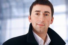 Close up of a Young Businessman. Close up portrait of a young businessman looking at you Stock Photography