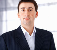 Close up of a Young Businessman. Close up portrait of a young businessman looking at you Royalty Free Stock Photo