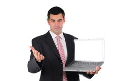 Close up of young businessman holding laptop Royalty Free Stock Images