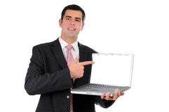 Close up of young businessman holding laptop Stock Image