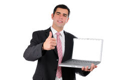 Close up of young businessman holding laptop Stock Photography