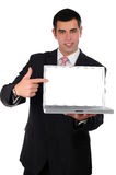 Close up of young businessman holding laptop Royalty Free Stock Image
