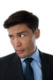 Close up of young businessman looking away Stock Photo