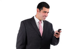 Close up of young businessman reading text message Royalty Free Stock Photography
