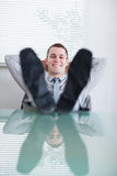 Close up of young businessman sitting back Stock Photo
