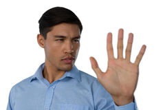 Close up of young businessman touching invisible screen Royalty Free Stock Photography