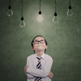 Close-up young businessman under lamps Royalty Free Stock Photos