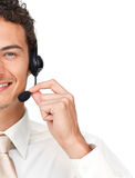 Close-up of a young businessman using headset. Isolated on a white background Royalty Free Stock Photo