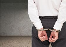 Close up on young businessman wearing handcuffs Stock Images