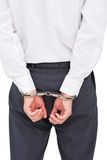 Close up on young businessman wearing handcuffs Stock Photography