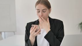 Close up of Young Businesswoman in Shock Using Smartphone stock video footage