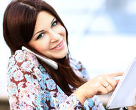 Close up of young businesswoman using digital tablet and mobile phone Royalty Free Stock Photo