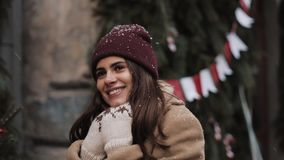 Close Up of Young Caucasian Pretty Girl Wearing Winter Hat, Putting Hands on chest, Walking and Looking Up at Christmas stock video