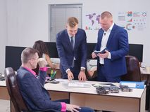 Young colleagues working in the office, Discussion.Cript currency. royalty free stock photos