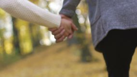 Close-up of young couple clasping hands in slow motion, romantic relationship. Stock footage stock video