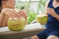 Couple drinking coconut cocktail stock photo